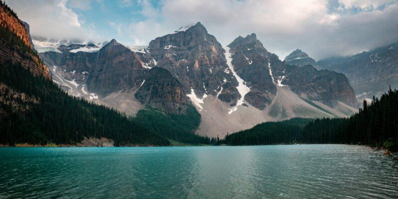 severe mountainous range near azure cold lake